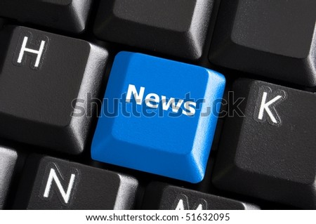 latest internet news concept with a blue button on computer keyboard - stock photo