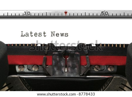 Latest News typed on an old typewriter. - stock photo