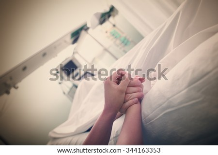Latest touch of the hand in the hospital - stock photo