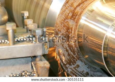 Lathe Turning Stainless Steel - stock photo