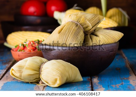 Latin American food. Traditional homemade humitas of corn and leaves - stock photo