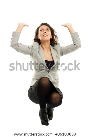 Latin businesswoman protecting herself from a giant object falling isolated on white - stock photo