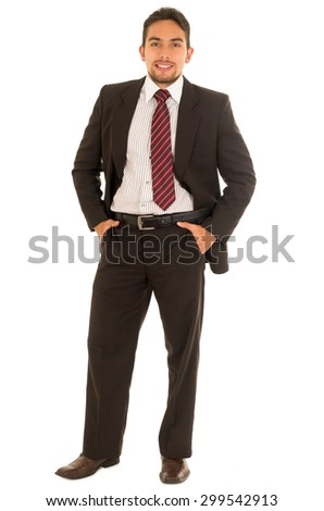 latin guy in a suit with red tie posing with hands in pockets isolated over white - stock photo