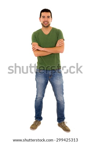latin man jeans green t-shirt standing crossing arms isolated on white - stock photo