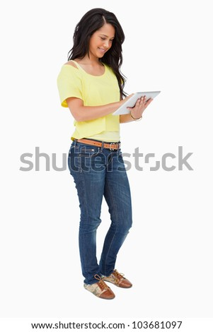 Latin student using a touch pad against white background - stock photo