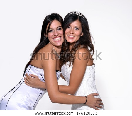Latin women friends hug and celebrating at party. - stock photo