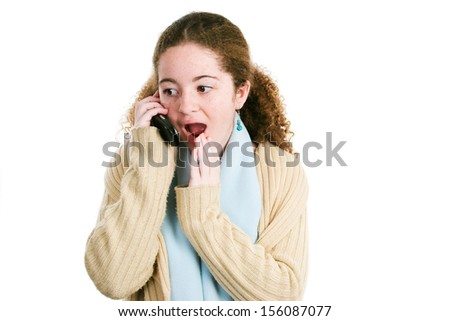 Latina tween teenage girl gossiping with friends on her cellphone.  Isolated on white.   - stock photo