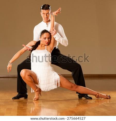 latino dance couple in action - dancing wild samba - stock photo