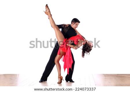 Latino dancers in ballroom against white background - stock photo