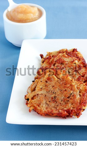 Latkes for Hanukkah served with applesauce - stock photo