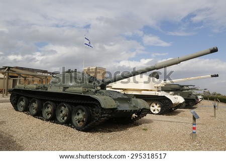 LATRUN, ISRAEL - NOVEMBER 27, 2014: Soviet made T-62 main battle tank at the front captured by IDF on display at Yad La-Shiryon Armored Corps Museum at Latrun  - stock photo