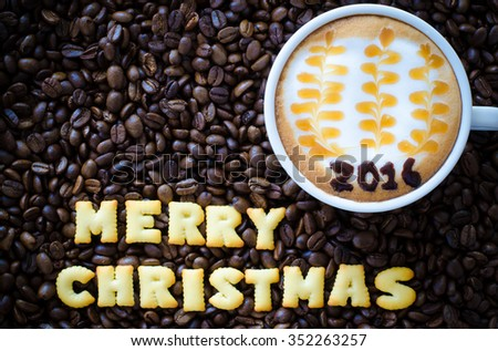 "latte art coffee and alphabet ""merry christmas"" made from bread cookies on coffee beans background - stock photo"