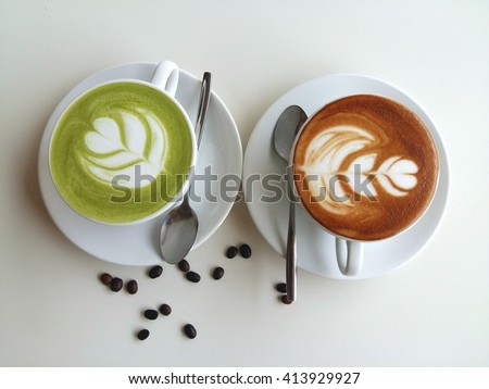Latte art coffee and matcha latte so delicious on white background - stock photo