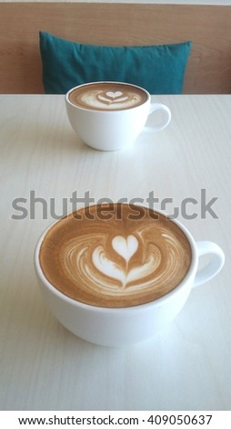 Latte art coffee isolated on table background  - stock photo