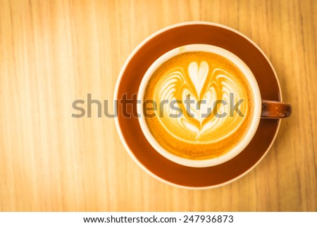 Latte art coffee process vintage style picture - stock photo