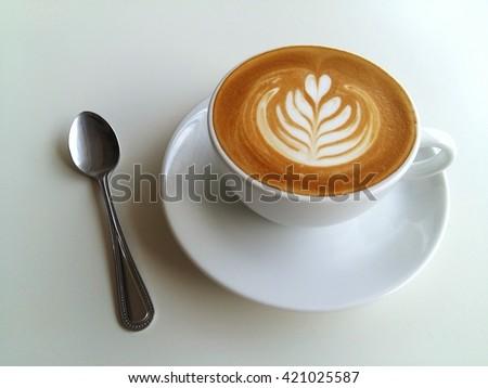 Latte art coffee so delicious on white background - stock photo