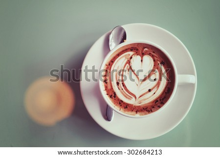 Latte art on top Mocha coffee drink in vintage style - stock photo