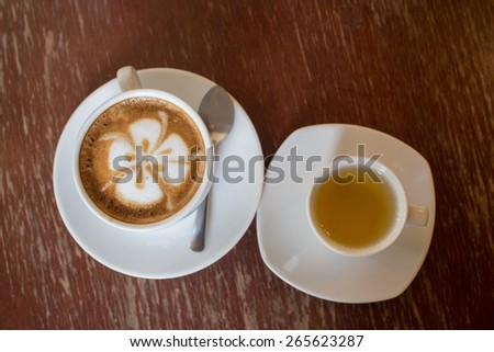 Latte coffee and  tea cup on wood - stock photo