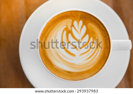 Latte Coffee art on the wooden table - stock photo