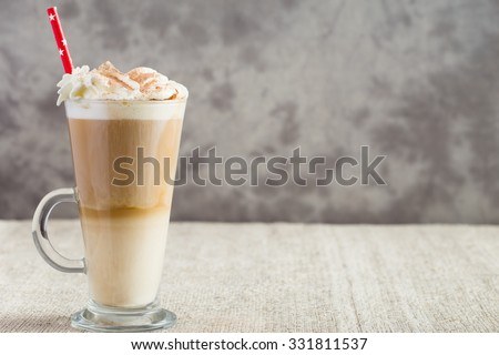 Latte coffee from left side of wooden table with copyspace - stock photo