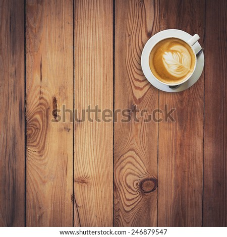 Latte coffee on wood with space - stock photo