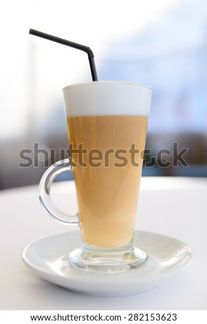 latte coffee with cream in transparent glass - stock photo