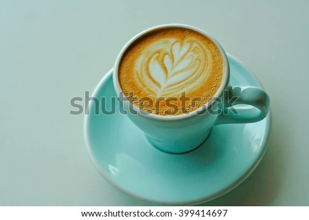 latte or cappuccino coffee on marble white desk in retro filter - stock photo