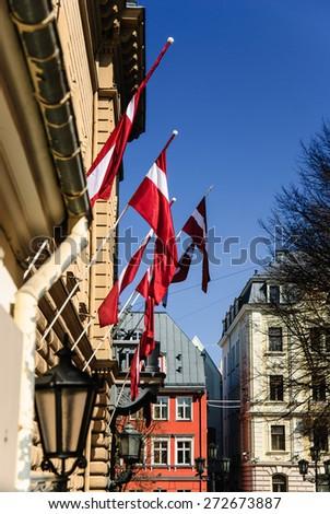 Latvian national flags at Riga old town, Riga, Latvia - stock photo