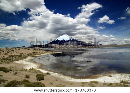 Lauca National Park, Chile, South America Volcano Parinacota and Lake Chungara in Chile's Andean range - stock photo