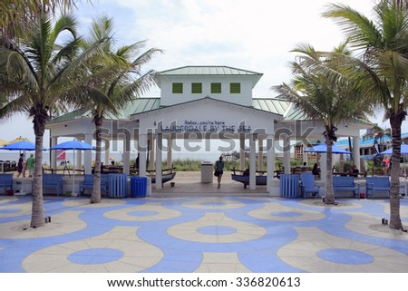 Lauderdale-By-The-Sea, FL, USA - September 20, 2014: Pavilion with a sign, Relax you are here LAUDERDALE-BY-THE-SEA. A beautiful walkway, people and beach with pavilion.  - stock photo