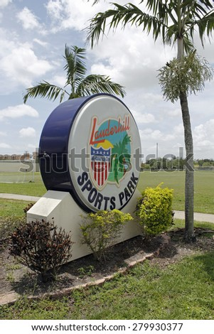 LAUDERHILL, FL, USA - JUNE 19, 2014: All-American City of Lauderhill Sports Park sign that is plastic, colorful and large in front of a soccer field. Entrance to part of Lauderhill Sports Park.  - stock photo