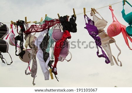 LAUGHARNE, CARMARTHENSHIRE - MAY 5 2014: Bras on a washing line, part of the set of National Theatre of Wales production of Llareggub, a celebration of Dylan Thomas in his home town of Laugharne. - stock photo