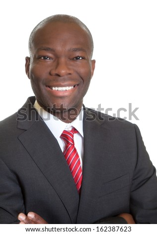 Laughing african businessman in a black suit - stock photo