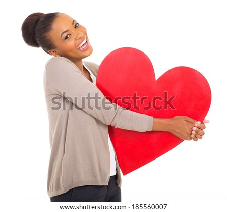 laughing afro american girl holding paper heart shape on white background - stock photo