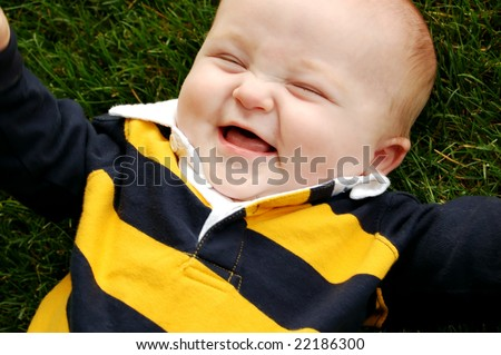 Laughing Baby Boy Outside - stock photo
