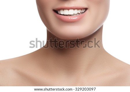 Laughing beautiful woman with clean fresh skin over white background. Beauty portrait. Woman smiling. Perfect fresh skin. Youth and skin care concept - stock photo