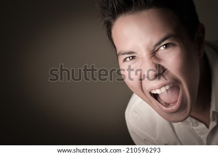 Laughing boy cring, shouting, screaming, hysteria on a brown background - stock photo