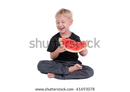 Laughing boy holding  a slice of watermelon - stock photo