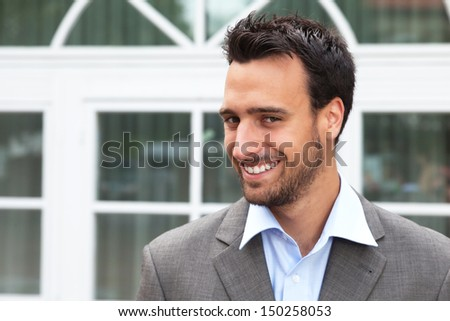 Laughing business man in a suit  - stock photo