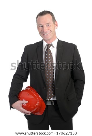 laughing businessman holding red helmet - stock photo