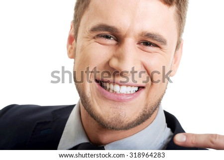Laughing businessman showing his perfect white teeth. - stock photo