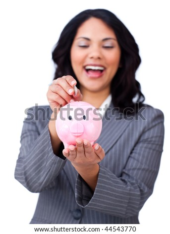 Laughing businesswoman saving money in a piggy-bank isolated on a white background - stock photo