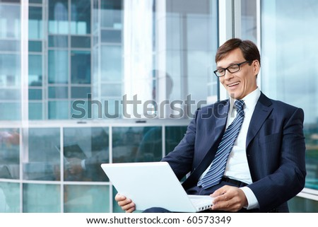 Laughing Chef with a laptop in the office - stock photo