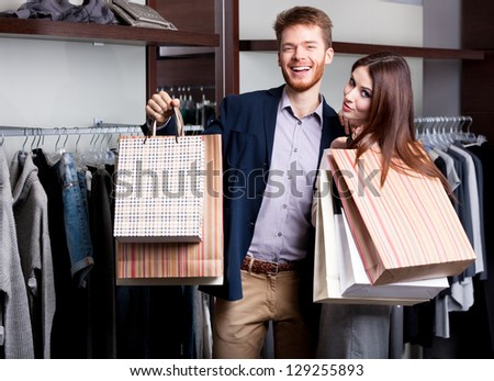 Laughing couple after shopping at the store - stock photo