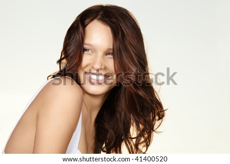 Laughing curly beauty under a sunlight, isolated - stock photo
