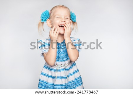 Laughing cute little girl on a white background - stock photo