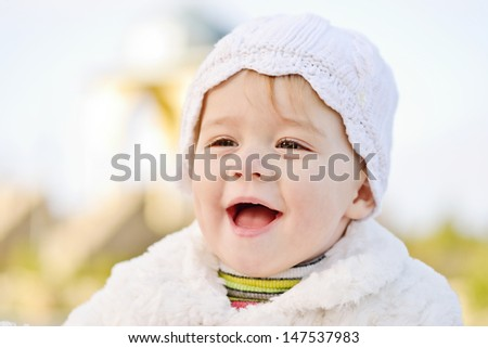 laughing face of baby girl  - stock photo