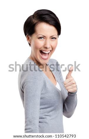 Laughing girl gives thumb up, isolated on white - stock photo