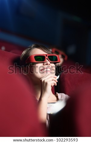 Laughing girl in 3D movie - stock photo