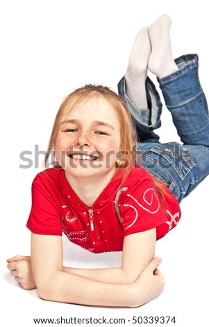laughing girl lies on floor isolated on white - stock photo